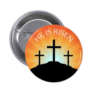 He is risen cross against sunrise Easter button