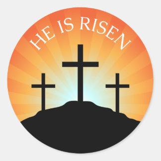 He is risen cross against sunrise Easter sticker