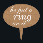 "&quot;he put a ring on it&quot;  Cake Pick on burlap<br><div class=""desc"">Cute,  and fun cake pick that is perfect for the engagement party,  bridal shower,  bachelorette or any wedding event where cake is served.</div>"