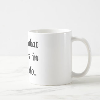 He was stirring up billows in a ladle. coffee mug