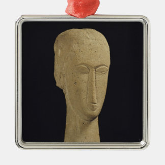 Head, c.1911-12 metal ornament
