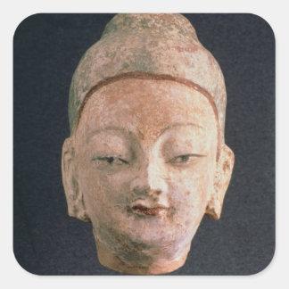 Head of a statue of Buddha, from Bezeklik Square Sticker