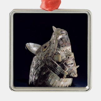 Head of an animal with human head in open jaws metal ornament