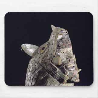 Head of an animal with human head in open jaws mouse pad