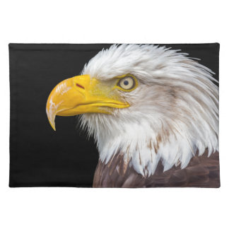 Head of bald eagle on black cloth placemat