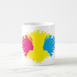 Head outlines in paint blotches. coffee mug