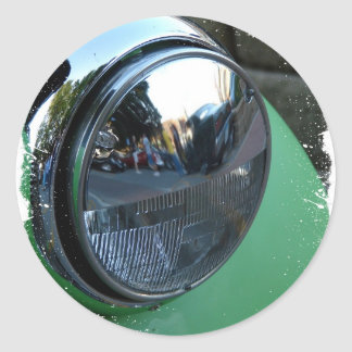 Headlight on a Green Vintage Car Classic Round Sticker