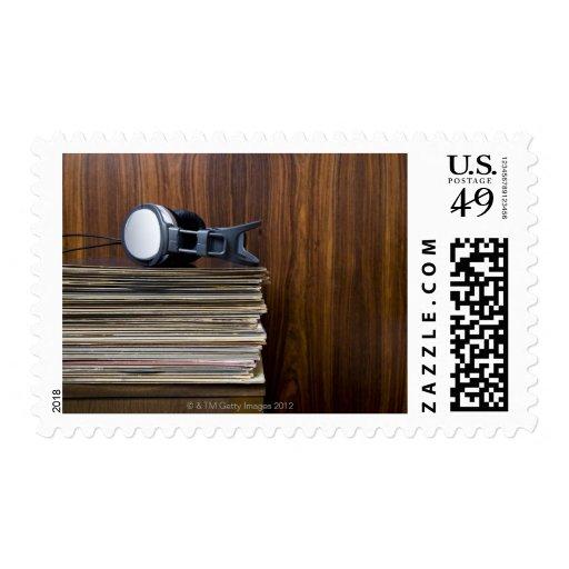 Headphones on Records Postage Stamp