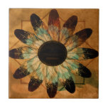 """Healing Feather Sun Tile<br><div class=""""desc"""">There are many different sun face symbols in Native American culture. The Kwakiutie sun is depicted with a mean face that represents healing and peace from the warmth and an abundant life. The Navajo sun symbol is a simple face design that was used to record heroic events and war stories...</div>"""