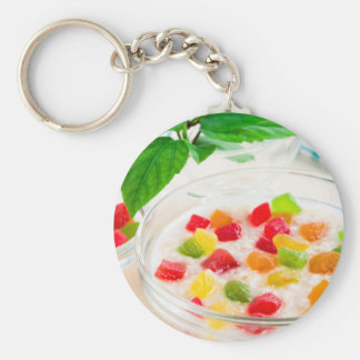 Healthy oatmeal close-up with candied fruit keychain