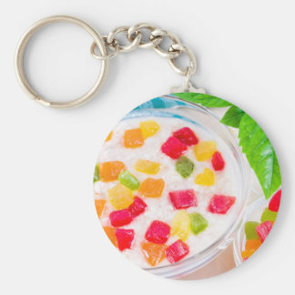 Healthy oatmeal close-up with colorful candied keychain