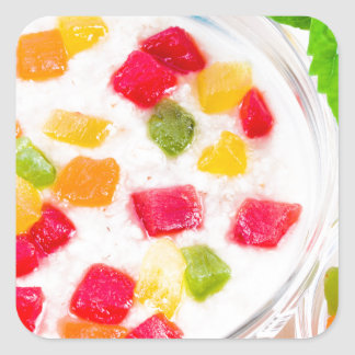Healthy oatmeal close-up with colorful candied square sticker