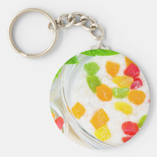 Healthy oatmeal close-up with colorful fruits keychain
