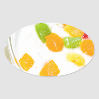 Healthy oatmeal close-up with colorful fruits oval sticker
