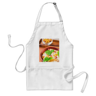 Healthy oatmeal with berries, raisins and herbs adult apron