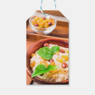 Healthy oatmeal with berries, raisins and herbs gift tags