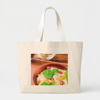 Healthy oatmeal with berries, raisins and herbs large tote bag