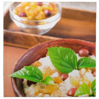 Healthy oatmeal with berries, raisins and herbs napkin
