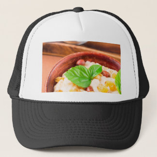 Healthy oatmeal with berries, raisins and herbs trucker hat