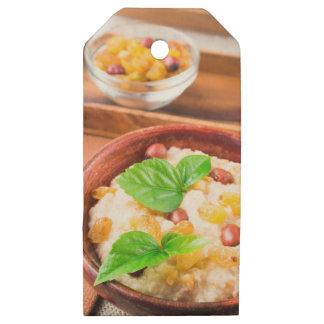 Healthy oatmeal with berries, raisins and herbs wooden gift tags