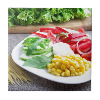 Healthy vegetarian dish of fresh vegetables tile