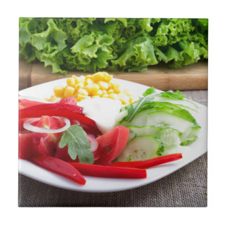 Healthy vegetarian dish on a gray textured fabric ceramic tile
