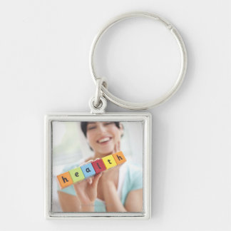 Healthy young woman, conceptual image. keychain
