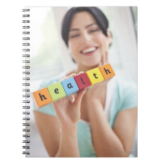 Healthy young woman, conceptual image. spiral note books