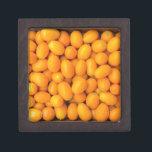 "Heap of orange kumquats in cardboard box<br><div class=""desc"">Heap of orange kumquats in cardboard box</div>"