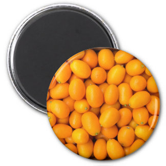 Heap of orange kumquats in cardboard box magnet