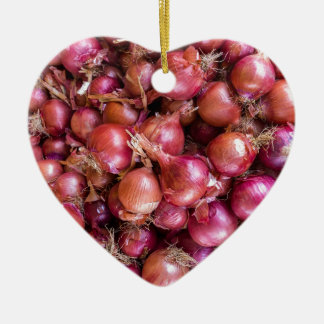 Heap of red onions on market ceramic ornament