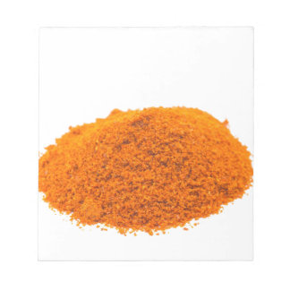 Heap of spice cayenne pepper powder on white notepad