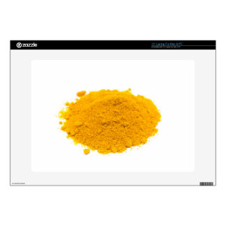 """Heap of spice turmeric powder on white background. 15"""" laptop skins"""