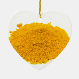 Heap of spice turmeric powder on white background. ceramic ornament