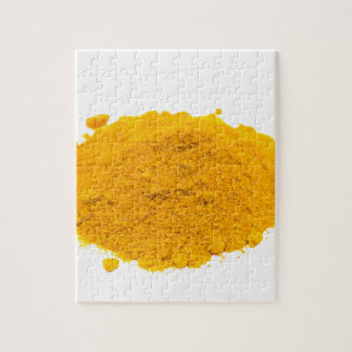 Heap of spice turmeric powder on white background. jigsaw puzzle
