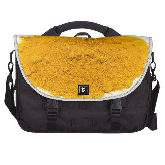 Heap of spice turmeric powder on white background. laptop bags