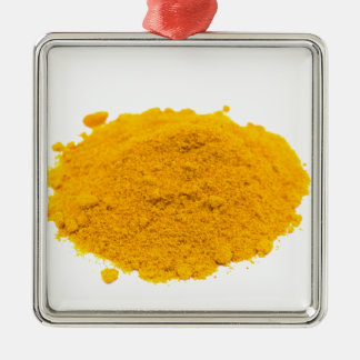 Heap of spice turmeric powder on white background. metal ornament