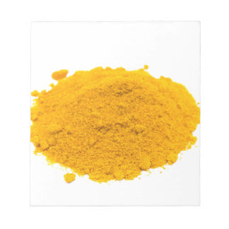 Heap of spice turmeric powder on white background. notepad