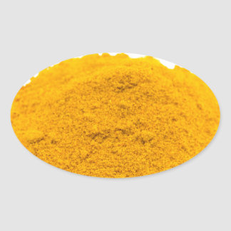 Heap of spice turmeric powder on white background. oval sticker