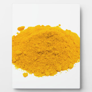 Heap of spice turmeric powder on white background. plaque