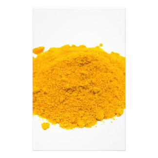 Heap of spice turmeric powder on white background. stationery