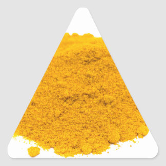 Heap of spice turmeric powder on white background. triangle sticker