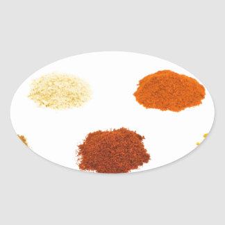 Heaps of several seasoning spices on white oval sticker