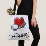 "Heart and Stethoscope Large Tote<br><div class=""desc"">What a wonderful gift for anyone in the medical field (nurse, doctor, ems ... . you name it ... ) or yourself! I did pay the extended license fees to legally offer all images as always on my Zazzle Products for you, and I only design on Zazzle. I have a...</div>"