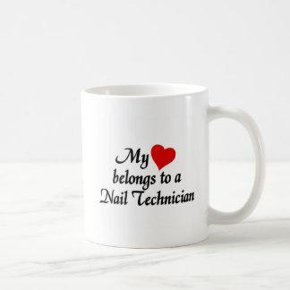 Heart belongs to a nail technician coffee mug