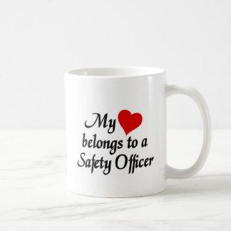 Heart belongs to a safety officer coffee mug