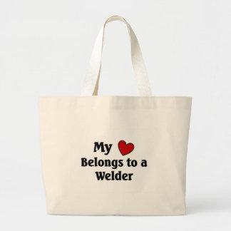 Heart belongs to a welder large tote bag
