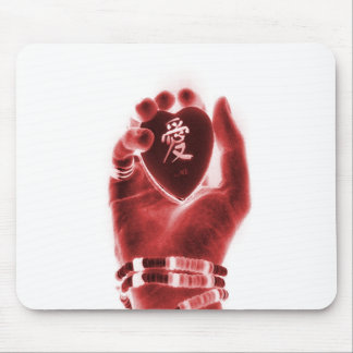 Heart in hand mouse pad
