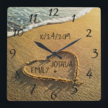 """Heart in the Sand Beach Shore Tropical Ocean View Square Wall Clock<br><div class=""""desc"""">Heart in the Sand Beach Shore clock features a beautiful, unique, custom, personalized design with a romantic summer tropical beach island background with a heart written, drawn in the sand along the blue ocean water to signify love and romance. Personalize this great item with the bride and groom names and...</div>"""