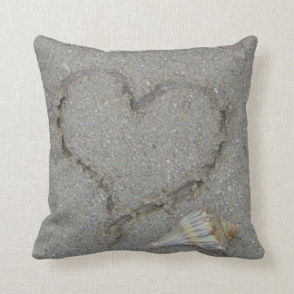 heart in the sand with shell throw pillows